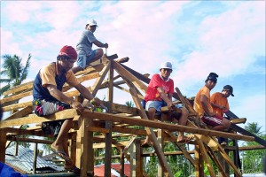 Residents in Basey, Western Samar building their new houses